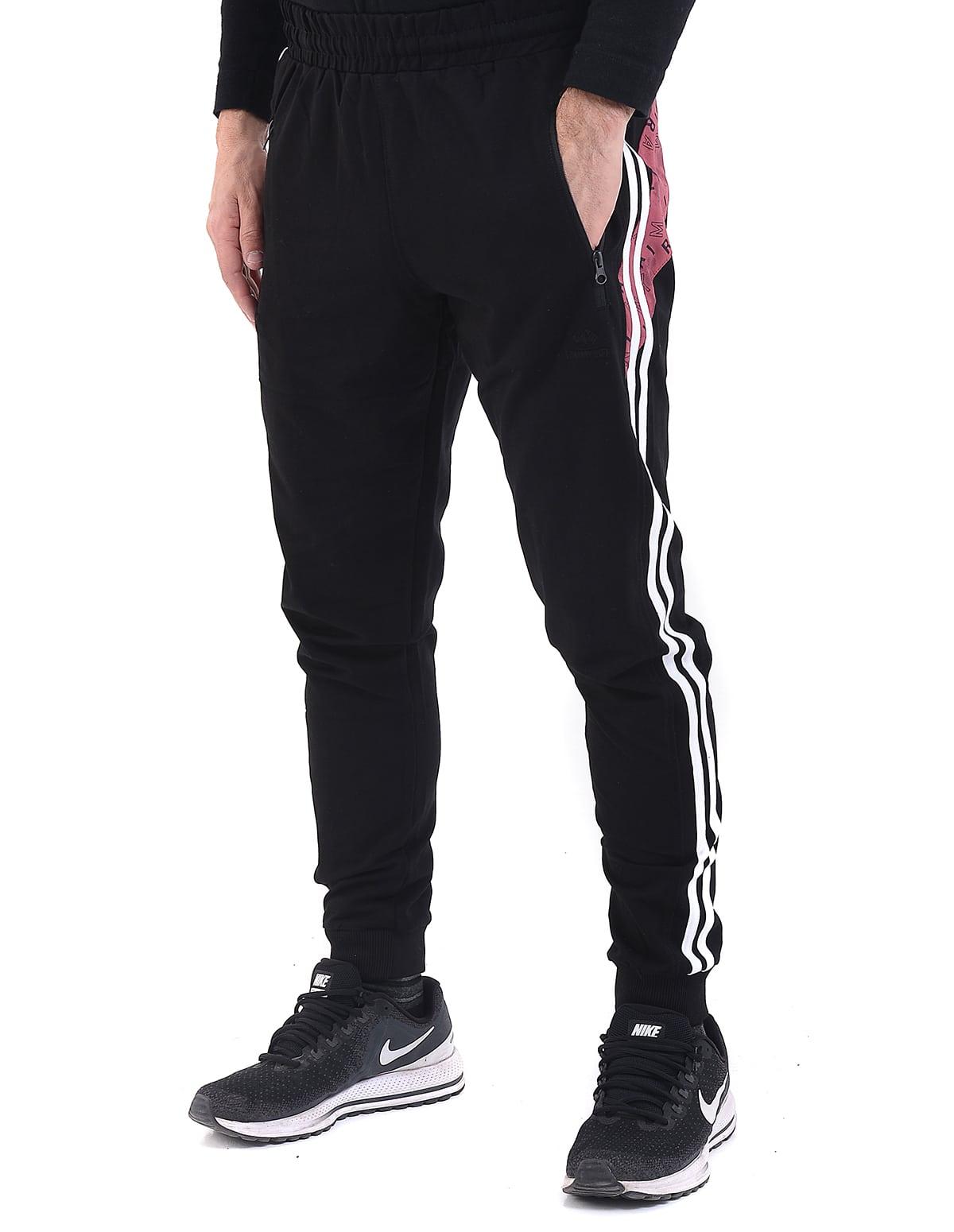 b83f30db0e99 Ανδρικό παντελόνι φόρμας jogger με λάστιχο στο πόδι σε μαύρο χρώμα και  λευκή ρίγα - vactive.gr